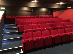 Removable front row seating in a theatre auditorium to allow wheelchair access