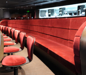 Swivel Chairs & Banquet Seating in a theatre stalls area