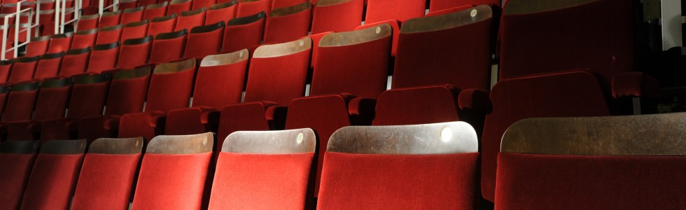 Ambassador theatre seating upholstered in red velvet fabric