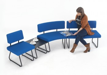 Upholstered seating unit with integral table for waiting or reception areas