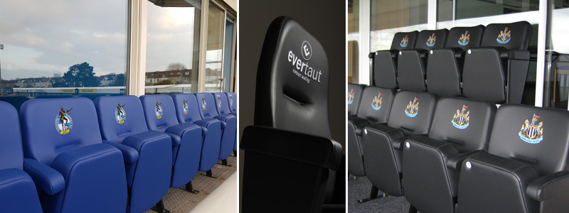Football stadium seating branded with club logos