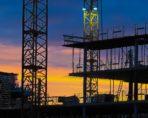Sun going down on construction site Construction decline 2017