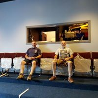 Manager and seating installer at Dibble Tree Theatre during installation of new seating