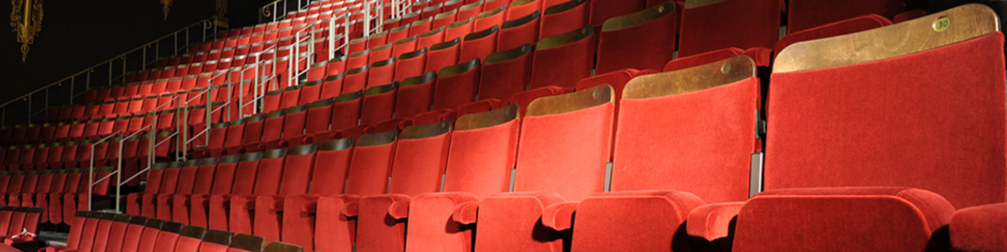 Theatre auditorium with Evertaut Ambassador theatre seating upholstered in red velvet