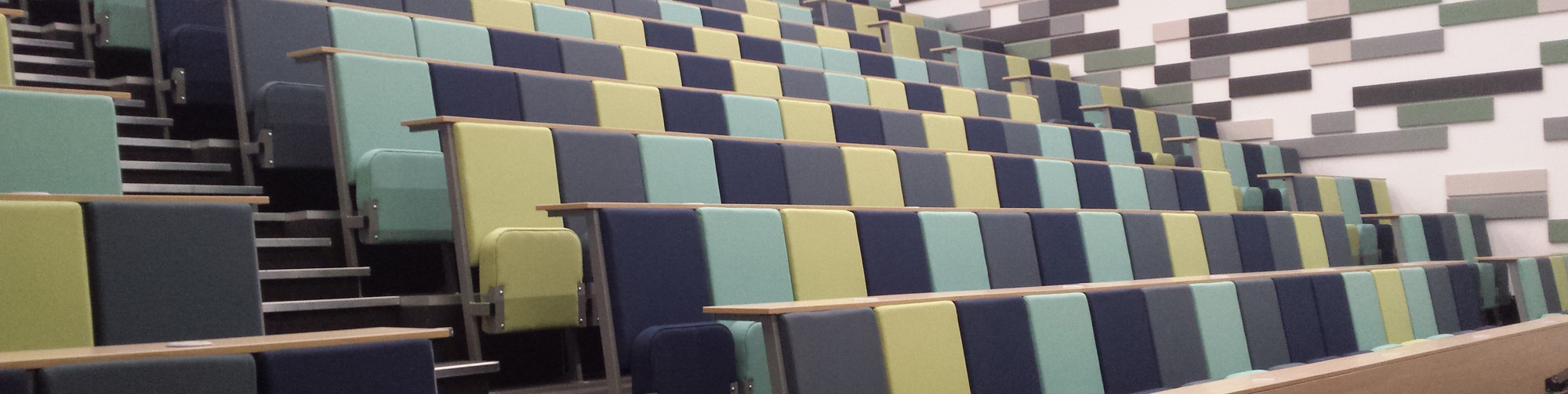 University lecture theatre with Evertaut Diploma lecture chairs upholstered in shades of green fabric