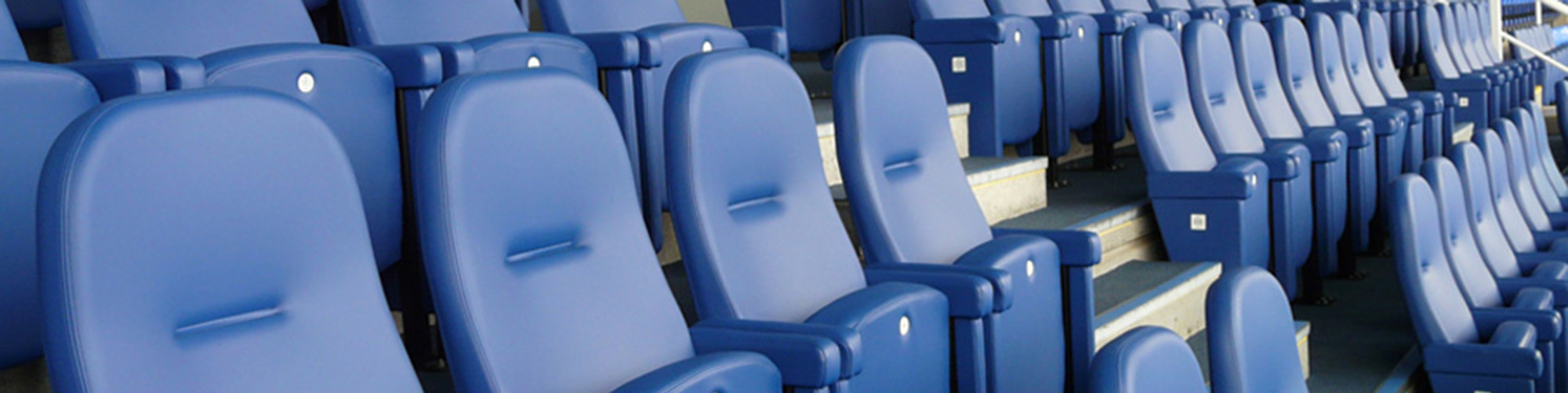 Football stadium with Evertaut Olympian luxury stadium seating upholstered in blue vinyl