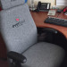 Directors chair with job title and company logo embroidered on seat back