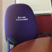 Purple office chair with Sales Manager wording embroidered on seat back