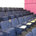 Lecture theatre with Evertaut Aspire Conference Seating upholstered in petrol blue fabric with flip-up writing tablets