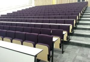 Evertaut Diploma lecture theatre seats upholstered in purple fabric
