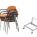Evertaut Delegate stacking chairs with arms upholstered in orange fabric with portable storage trolley