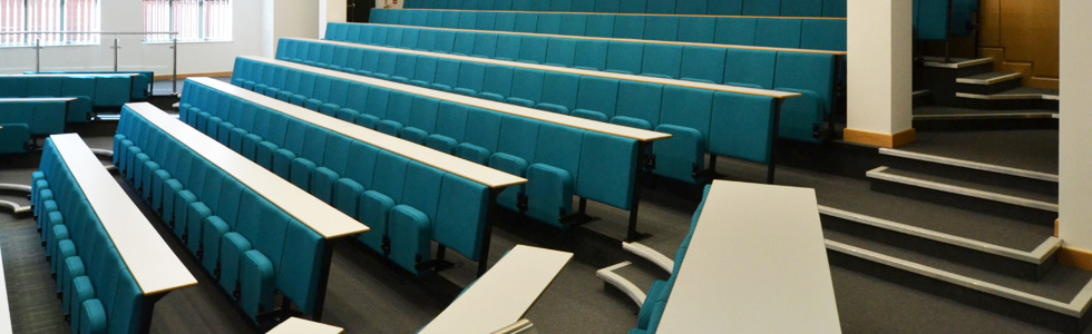 Lecture theatre with Evertaut Diploma Lecture Theatre Seating upholstered in bright aqua blue fabric with white laminate desks