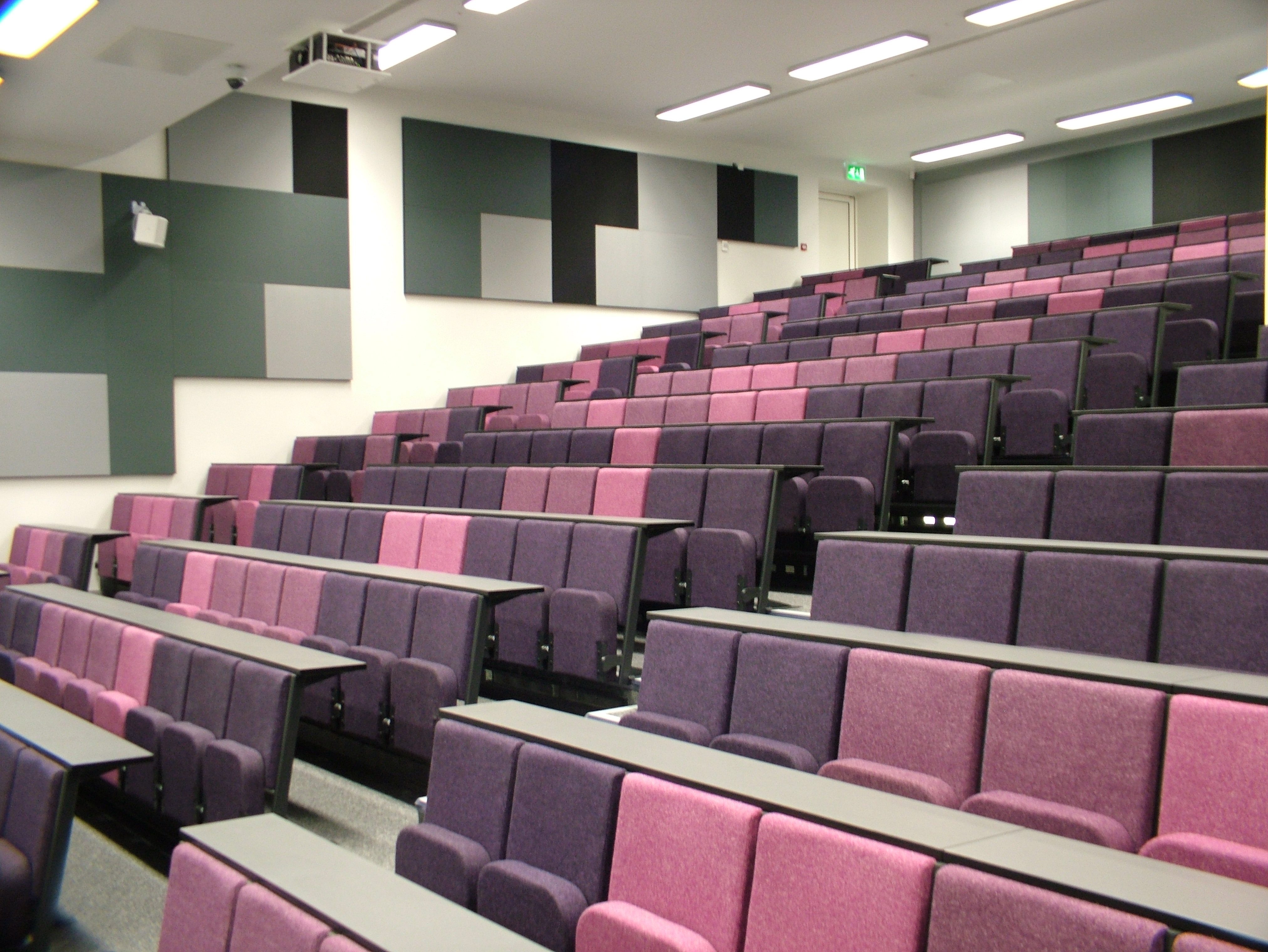 Evertaut Diploma lecture theatre seating in shades of pink and heather colours