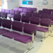 Hospital waiting room with Evertaut Dandi beam seating upholstered in purple coloured vinyl