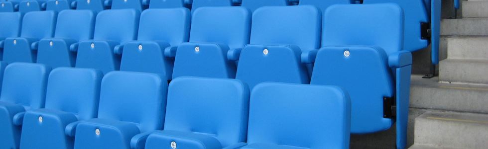 Evertaut VIP stadium seating upholstered in bright blue vinyl with silver underseat numbers