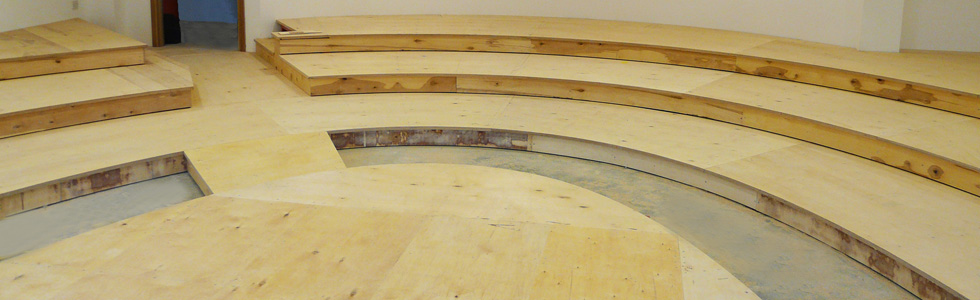 Evertaut tiered flooring in a lecture theatre pictured mid installation