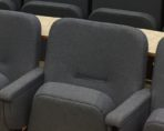 Evertaut Aspire and Diploma fixed conference seating in blue grey fabric with integral laminated desks in curved rows