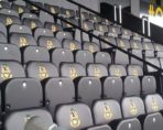 Black upholstered Club seats in a football stadium