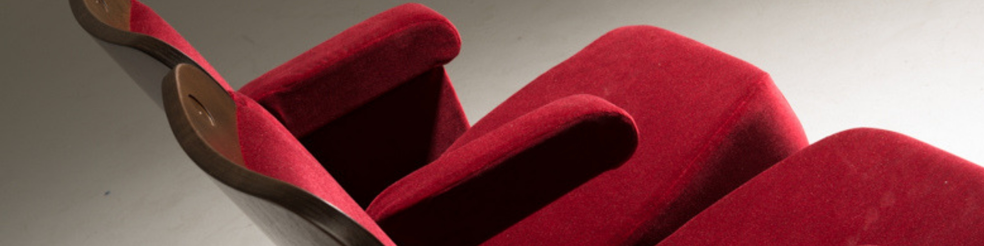 Close up of Evertaut Ambassador theatre seat upholstered in red velvet