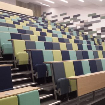 Large university lecture theatre with Evertaut Diploma lecture chairs in different shades of green fabric