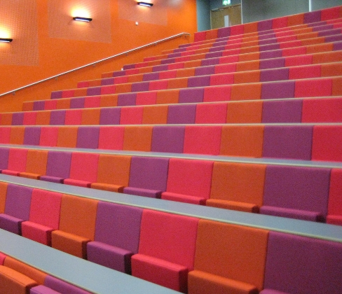 University lecture theatre with purple pink and orange fabric seats