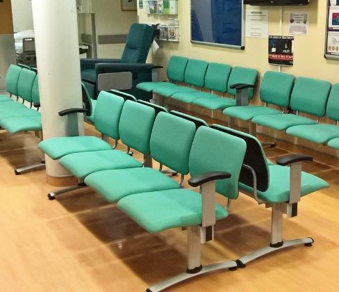 Rows of beam seating in a hospital waiting room