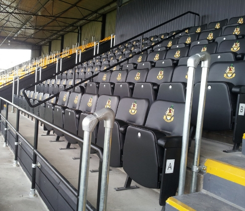 Football stadium with Evertaut VIP stadium seating upholstered in black vinyl