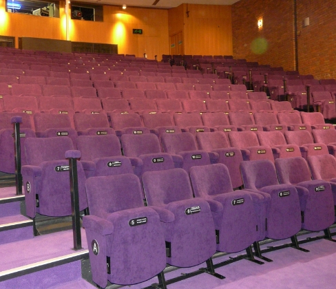 Theatre auditorium with Evertaut Orion theatre seats upholstered in purple fabric