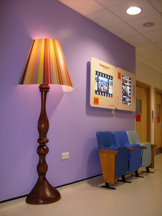 Evertaut blue Bradford Beam waiting room chairs in hospital corridor