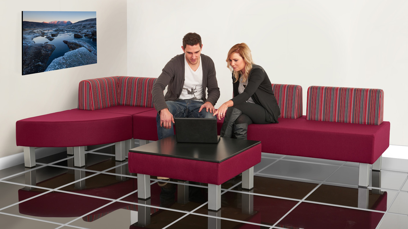 2 people looking at a laptop in an office waiting room sitting on Evertaut E-System reception seating