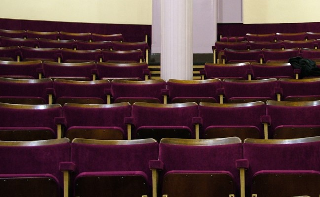 Close up of purple fixed seating in a theatre after refurbishment