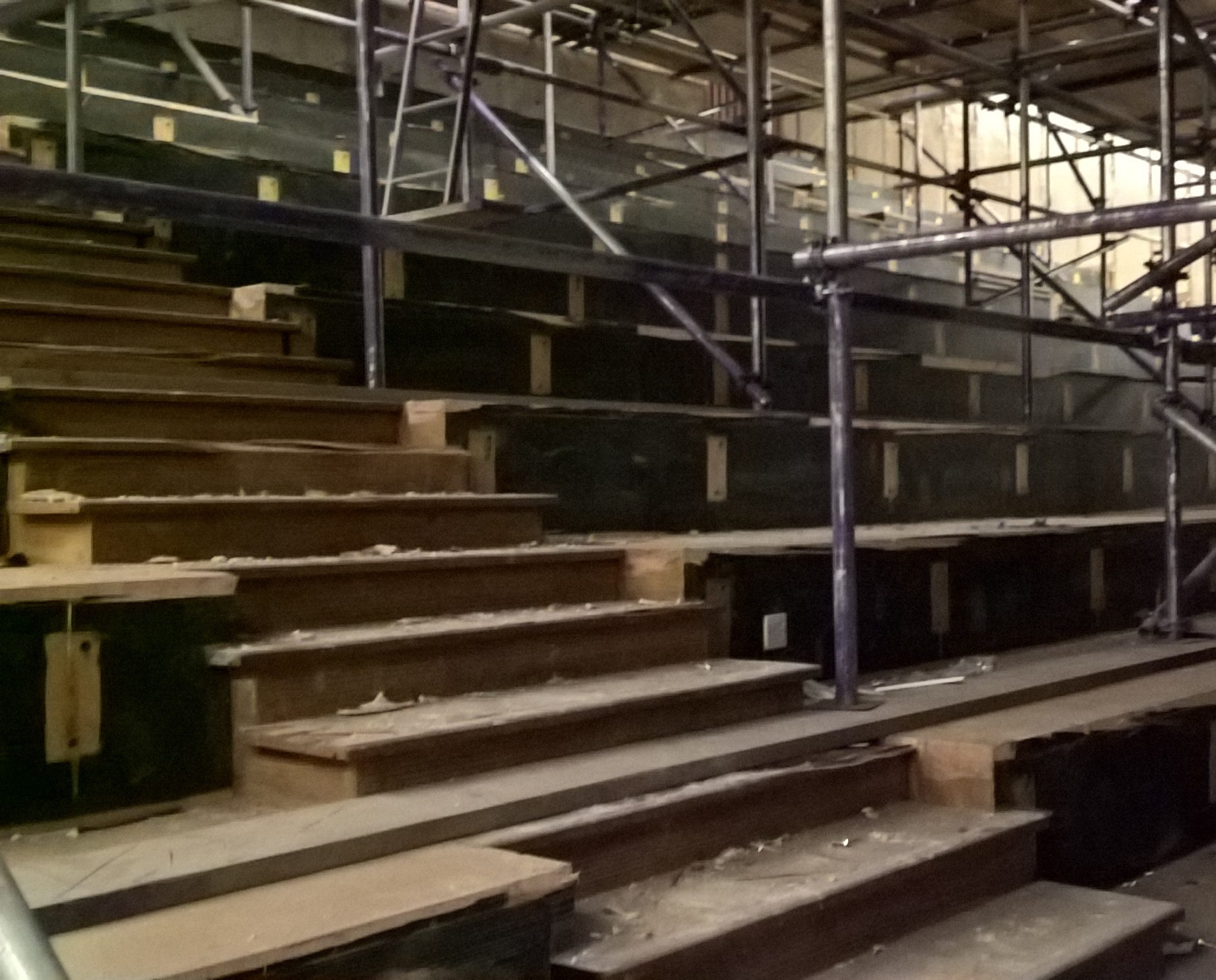 Lecture theatre in a university with scaffolding during early stages of refurbishment