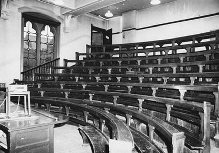 Example of late nineteenth century lecture theatre with wooden bench seating