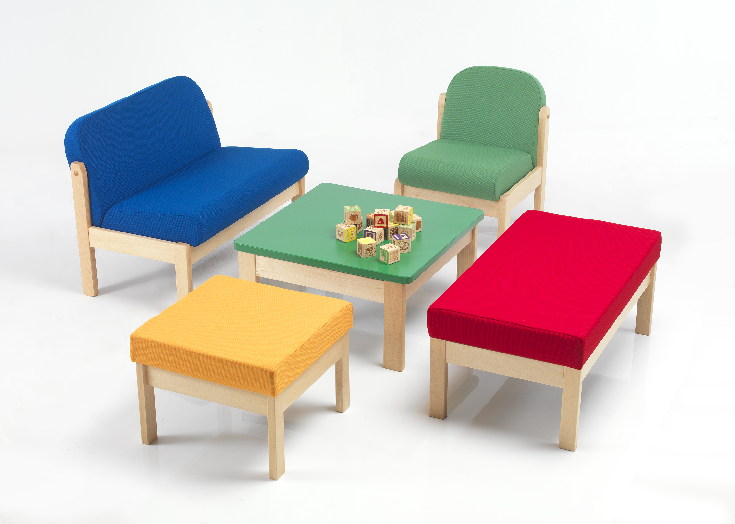 Children's sofa, chair and stools upholstered in primary colours with small table