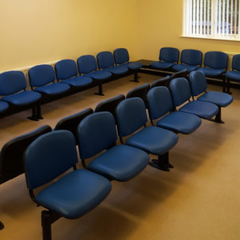 Waiting room with Evertaut Dual Beam seating upholstered in blue vinyl