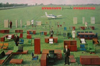 Front cover of Evertaut 1966 catalogue showing office furniture on field at Birmingham Airport with plane in background