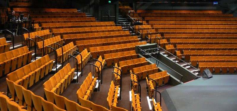 Yellow fabric colour for fixed seating shown on theatre seats in an auditorium
