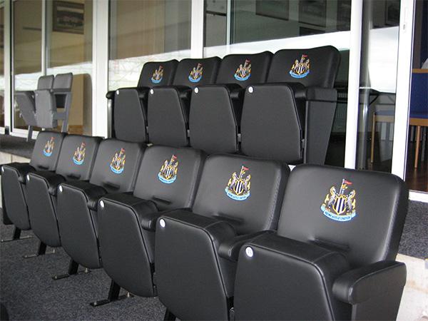 Branded upholstered stadium seating outside Director's box at Newcastle Utd