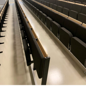 Installation of Diploma lecture theatre seating with individual folding desks in university
